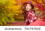 young woman with red umbrella... | Shutterstock . vector #701747020