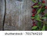 cherry on wooden surface | Shutterstock . vector #701764210