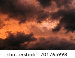 clouds against the orange sky.... | Shutterstock . vector #701765998