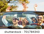 group of happy young friends in ... | Shutterstock . vector #701784343