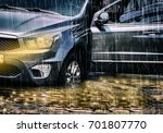 car swamped in flood water ... | Shutterstock . vector #701807770