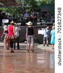 Small photo of PORTLAND, OREGON - JUL 1, 2017 - Dancers sway to the music at the 4th of July weekend Blues festival in Portland, Oregon