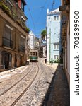 Small photo of LISBON, PORTUGAL - JUNE 25, 2016: Classic Remodelado tram number 28 navigates the steep incline between old houses of Alfama. Lisbon. Portugal