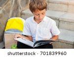 cute schoolboy studying...   Shutterstock . vector #701839960