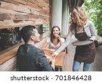 portrait of a female waitress... | Shutterstock . vector #701846428