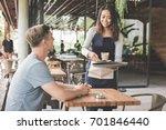 portrait of a female waitress... | Shutterstock . vector #701846440