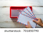 hands are picking up the... | Shutterstock . vector #701850790