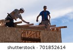 men build roof for home for...