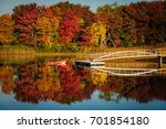 dinghy on lake with fall... | Shutterstock . vector #701854180