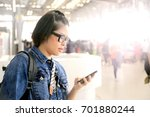 the asian woman at the airport | Shutterstock . vector #701880244