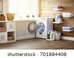 interior of a real laundry room ... | Shutterstock . vector #701884408