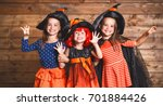 Stock photo laughing funny children sister twins girl in a witch costume in halloween 701884426