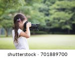 happy little girl taking... | Shutterstock . vector #701889700