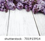 lilac flowers on a old wooden... | Shutterstock . vector #701915914