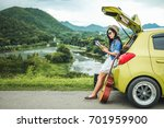 woman tourist sitting on... | Shutterstock . vector #701959900