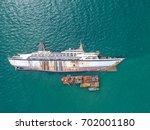 Boat crashes in the sea, cruise ship ,accident ,Shipwreck,top view ,aerial view - stock photo