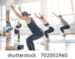 group women stretching and... | Shutterstock . vector #702001960