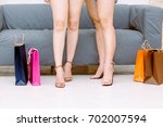 woman legs near colorful... | Shutterstock . vector #702007594