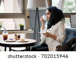 arab women in hijab holding and ... | Shutterstock . vector #702015946