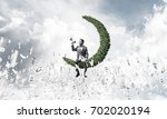 young businessman sitting on... | Shutterstock . vector #702020194