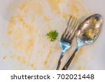 top view of stained plate with... | Shutterstock . vector #702021448