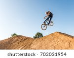bmx rider performing a look... | Shutterstock . vector #702031954