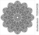 lacy hand drawn round pattern.... | Shutterstock .eps vector #702034528