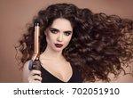 salon beauty. curly hair. close ... | Shutterstock . vector #702051910