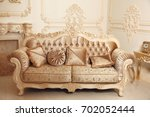 royal sofa with pillows in... | Shutterstock . vector #702052444