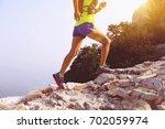 trail runner woman running at... | Shutterstock . vector #702059974