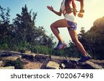 trail runner woman running at... | Shutterstock . vector #702067498