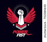 strong fist of a muscular man... | Shutterstock . vector #702084640