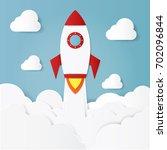 illustration of flying rocket... | Shutterstock .eps vector #702096844