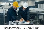 two engineers discuss a... | Shutterstock . vector #702098404