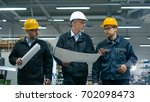 senior engineer and two workers ... | Shutterstock . vector #702098473