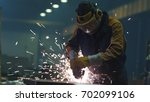 heavy industry worker at a... | Shutterstock . vector #702099106