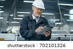 senior engineer in hardhat is... | Shutterstock . vector #702101326
