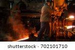 heavy industry worker working... | Shutterstock . vector #702101710