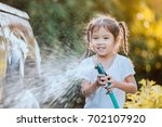 happy asian child girl help... | Shutterstock . vector #702107920
