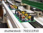 manual insertion of electronic... | Shutterstock . vector #702111910