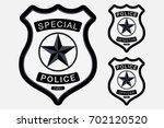 police badge simple monochrome... | Shutterstock .eps vector #702120520