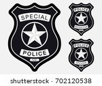 police badge simple monochrome... | Shutterstock .eps vector #702120538
