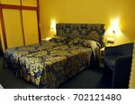 bedroom with golden flowers... | Shutterstock . vector #702121480