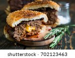 big burger with cheddar cheese | Shutterstock . vector #702123463