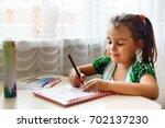 portrait of brunette schoolgirl ...   Shutterstock . vector #702137230