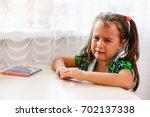 little girl crying doing her...   Shutterstock . vector #702137338