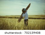 freedom  boy playing to be... | Shutterstock . vector #702139408