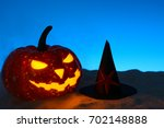 carved grinning pumpkin with... | Shutterstock . vector #702148888