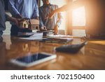 business meetings of real... | Shutterstock . vector #702150400