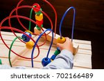 kids hands playing wooden wire... | Shutterstock . vector #702166489